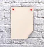 Note paper with push pins. On brick wall Royalty Free Stock Photography