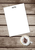 Note paper put on a old grunge wooden texture table with a cup hot coffee,top view, space for add your text or graphic editor Royalty Free Stock Photo