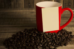 Note paper and red cup coffee on wood  table Stock Image