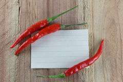 Note paper and Red peppers. Stock Image