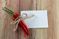 Note paper and Red peppers. Stock Images