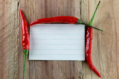 Note paper and Red peppers. Royalty Free Stock Image