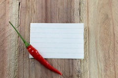 Note paper and Red peppers. Royalty Free Stock Images