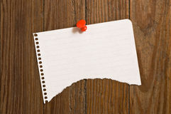 Note paper with red thumbtack. Stock Photos