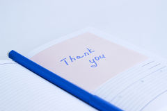Note on the paper THANK YOU Royalty Free Stock Images