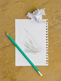 Note, paper to disposable and pencil on wooden Royalty Free Stock Images