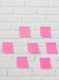 Note paper on white brick wall Stock Photo