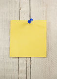 Note paper on wood. En background Stock Photo
