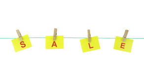 Note papers hanging with wood pegs on clothesline. Stock Photos