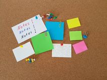 Note papers pinned on cork board, Office supply, School supplies, Message board stock image
