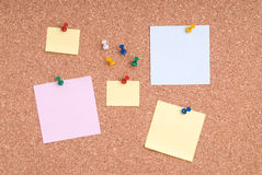 Note Papers With Tacks On Cork Surface Royalty Free Stock Photography