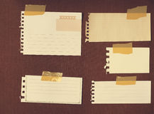 Note papers for your message. On grunge wood background ,vintage filtered image royalty free stock photography