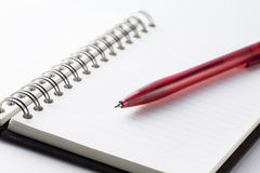 Note and pen. Pen over note book to write Royalty Free Stock Photos