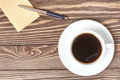 Note, pen and cup of coffee Stock Image