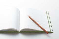 Note and pencil Stock Images