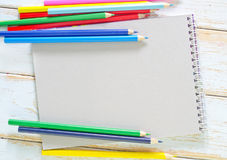 Note and pencils Stock Photos