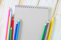 Note and pencils Stock Photography