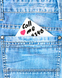 A note with a phone number in a pocket of jeans Royalty Free Stock Image