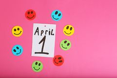 Note with phrase. `April 1` on color background. Fool`s day composition Stock Image