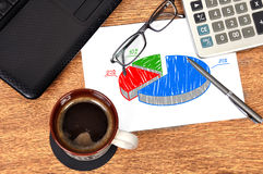 Note pie chart. On table businessman Stock Photos
