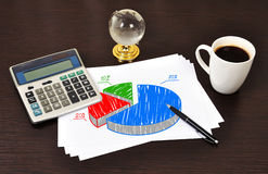 Note pie chart. On table businessman Stock Images