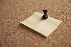 Note pinned to a cork board Royalty Free Stock Photo