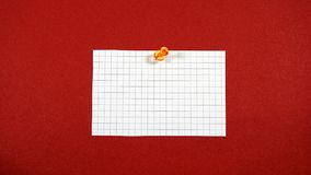 Note with a pushpin. A note with a pushpin on a red background Stock Photo