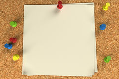 Note and pushpins on a cork board Stock Photography