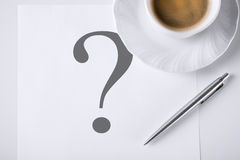 Note with question mark and coffee Royalty Free Stock Photo