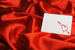 Note on red silk Stock Image