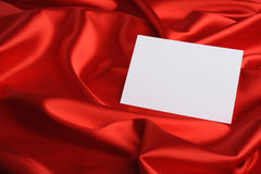 Note on red silk Royalty Free Stock Image