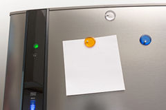 A note on a refrigerator. Stock Photos