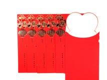 Note rouge d'enveloppe et de papier sur le fond blanc Photographie stock libre de droits