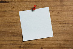 Note with Tack. Note with Tack on wooden board Stock Image
