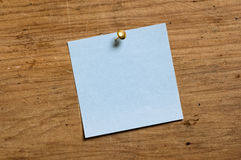 Note with Tack. Note with Tack on old wooden board royalty free stock photography