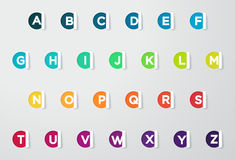 Note tagliate carta del cerchio con le lettere variopinte dell'alfabeto Fotografia Stock