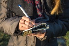 Note taking and brainstorming outdoors. Close-up Stock Photography