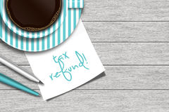 Note with tax refund text, coffee, and stationery Royalty Free Stock Image