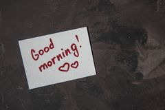 Note with text Good morning on a dark background.  Royalty Free Stock Images