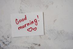 Note with text Good morning on a white background.  Stock Photo