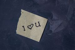 Note with text i love you on a dark background Stock Images