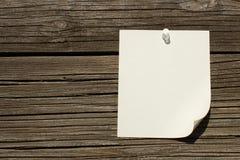 Note thumb tacked on wood Stock Photos