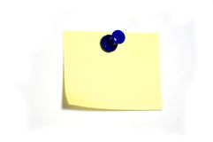 Note with thumbtack. Blank yellow note with blue thumbtack Stock Photography