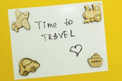 A note `time to travel` with transport figures on a yellow background.  royalty free stock image