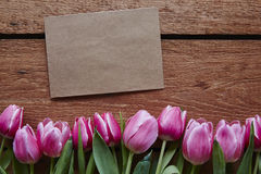 A note for valentines day spring atmosphere tulips Royalty Free Stock Photo