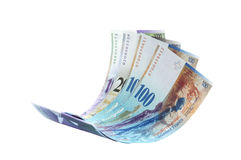 Note volante de franc suisse photo stock