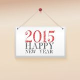 Note on the wall. Congratulations to the Happy New Year 2015 Royalty Free Stock Image