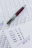 A note with the win selection of the winning codes on bookmakers Stock Photography