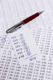 A note with the win selection of the winning codes on bookmakers Royalty Free Stock Photo