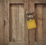 Note on wood door Stock Images